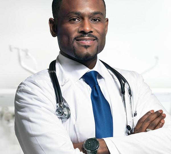 a man wearing white coat