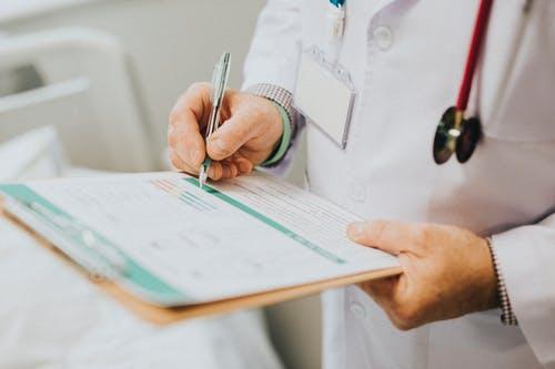 A doctor prescribing